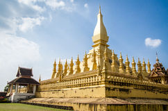 The golden pagoda Pha That Luang in Vientiane, Laos. Laos travel landmark. Famous tourist destination in Asia. Pha That Luang is a gold-covered large Buddhist Stock Photos