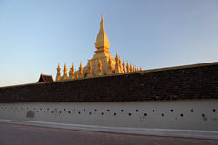 Pha That Luang is a large gold-covered Buddhist stupa in the centre of Vientiane, Laos Royalty Free Stock Photo
