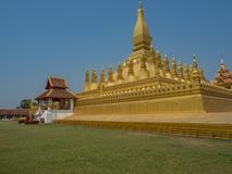 Pha That Luang. Vientiane,  Laos. Pha That Luang, Great Stupa, a massive gold-leaf covered temple complex in the centre of Vientiane. Clear blue sky. Laos, Lan Stock Photo