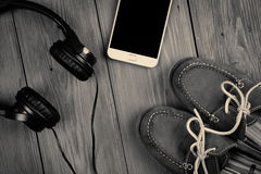Phablet and headphones on the wooden desk Royalty Free Stock Images