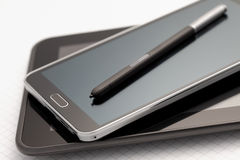 Phablet with selective focus on stylus pen Royalty Free Stock Photos