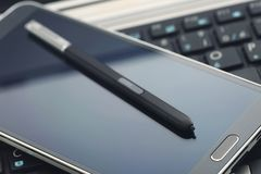 Phablet with stylus pen Royalty Free Stock Images