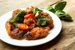 Phad Phed Pla Duk Thod Krob (Stir fried Deep fried Catfish with Royalty Free Stock Photo