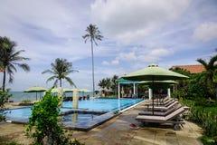 Swimming pool at seaside hotel in Vietnam. Phan Thiet, Vietnam - Mar 26, 2017. Swimming pool at a luxury resort in Phan Thiet, Vietnam. Phan Thiet belongs to Stock Photo