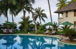 Swimming pool in Phan Thiet, Vietnam. Phan Thiet, Vietnam - Mar 26, 2017. Swimming pool of resrort with palm trees in Phan Thiet, Vietnam. Phan Thiet belongs to Royalty Free Stock Image