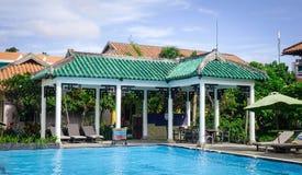 Swimming pool at seaside hotel in Vietnam. Phan Thiet, Vietnam - Mar 26, 2017. Swimming pool at sunny day in Phan Thiet, Vietnam. Phan Thiet belongs to Binh Stock Images