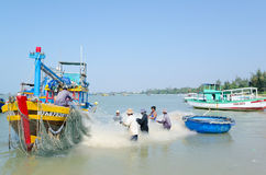 Vietnamese fishers at work Stock Images