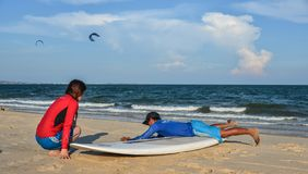Surf school students training on beach stock photography