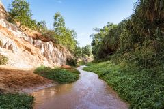 Phan Tiet, Vietnam. Fairy Stream Canyon, Mui Ne, Vietnam, Southeast Asia. Beautiful scenic landscape with red river, sand dunes. And jungle. Tropical oasis stock image