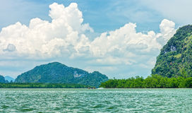 Phang Nga bay and mountain view with dramatic cloud and blue sky. Phang Nga bay is in Phang Nga national park of Thailand Royalty Free Stock Photography