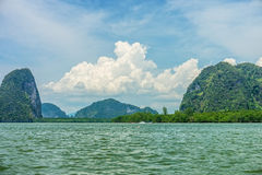 Phang Nga bay and mountain view with dramatic cloud and blue sky. Phang Nga bay is in Phang Nga national park of Thailand Stock Photography