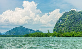 Phang Nga bay and mountain view with dramatic cloud and blue sky. The nay is in Phang Nga national park of Thailand Royalty Free Stock Image
