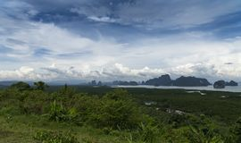 Phang Nga Bay - view from the observation deck. 5. Green mountainous islands swim in the azure sea. View from the top of the island royalty free stock photo