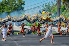 Phang Nga, Thailand - October 15, 2018: Group of men performing dragon dance on street marching in vegetarian festival parade in stock image