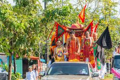 Phang Nga, Thailand - October 15, 2018: People in Chinese costume on back of pickup car act as assumed Chinese god marching on stock photography