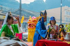 Phang Nga, Thailand - October 15, 2018: People in Chinese costume being assumed Chinese gods blessing people who pay respect to royalty free stock images