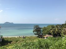 Phangan island in Thailand. View from the coast to the ocean and the island in the distance stock photos