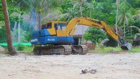 PHANGAN, THAILAND - March 28,2017:excavator working in the tropics stock footage