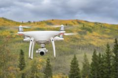 Phantom drone flying in mountains Royalty Free Stock Images