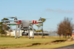 Drone flying with trees in background Royalty Free Stock Photography