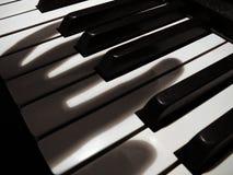 Phantom musician #3. Shadow fingers on piano keys Stock Photo