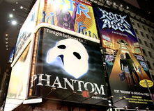 Phantom of the Opera. Advertisement on Times Square, New York for the famous broadway show, Phantom of the Opera. It is the longest running show on broadway Royalty Free Stock Photos