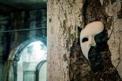 Phantom of the Opera mask. In dark tunnel Royalty Free Stock Photo
