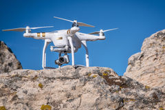 Phantom quadcopter drone on a cliff Stock Images