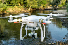 Phantom quadcopter drone flying over river Royalty Free Stock Photos