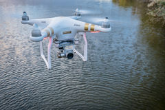 Phantom quadcopter drone flying over water Royalty Free Stock Photography