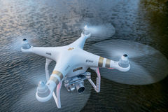 Phantom quadcopter drone flying over water Stock Images