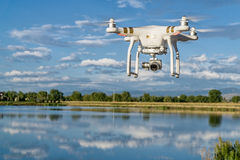 Phantom quadcopter drone flying over water Royalty Free Stock Images