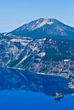 Phantom Ship Island, Crater Lake, Oregon, U.S.A. Crater Lake in Oregon on a calm sunny day. Crater Lake is a caldera lake located in the south-central region of Royalty Free Stock Image