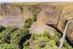 Phantom Waterfall dropping off over vertical basalt walls, North Table Mountain Ecological Reserve, Oroville, California royalty free stock image