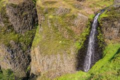 Phantom Waterfall dropping off over vertical basalt walls, North Table Mountain Ecological Reserve, Oroville, California royalty free stock photos