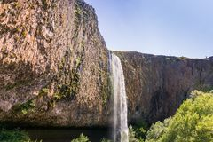 Phantom Waterfall dropping off over vertical basalt walls, North Table Mountain Ecological Reserve, Oroville, California royalty free stock images