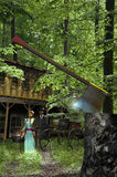Phantoms in the woods. Old wooden house in the forest, with a cart at the door Royalty Free Stock Images