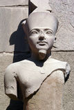 Pharaoh. Young pharaoh and wall of Karnak temple in Luxor, Egypt royalty free stock image