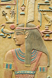 Pharaoh, Egyptian background. Pharaoh with long black hair and decorative ornaments, picture - souvenir from Egypt royalty free stock images