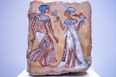 Pharaoh and his wife from 14th century BC on stone egyptian relief Stock Image