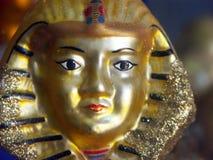 Pharaoh mask. Old gilded pharaoh mask royalty free stock photography