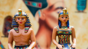 Pharaoh and Queen figurines on blurred background Royalty Free Stock Photo