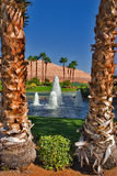 Pharaoh's dream. Blue lake and fountains on palms background stock photos