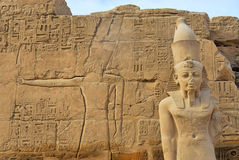 Pharaoh statue in Karnak. The Karnak Temple Complex comprises a vast mix of decayed temples, chapels, pylons, and other buildings. Building at the complex began Stock Image