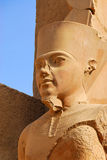 Pharaoh statue in Karnak. The Karnak Temple Complex comprises a vast mix of decayed temples, chapels, pylons, and other buildings. Building at the complex began Stock Photo