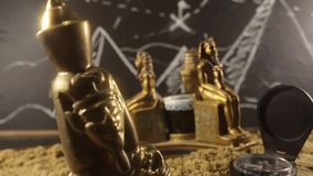 Pharaoh Statues on a sand video. stock footage