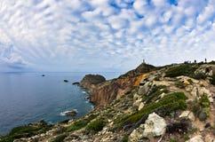 Phare au capo Sandalo sur la côte ouest de l'île de San Pietro, Sardaigne Images stock