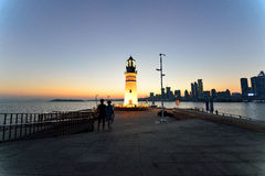 Phare au coucher du soleil Photos stock