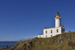 Phare côtier de plaine écossaise historique photos stock