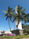 Phare couvert par des palmiers photo libre de droits